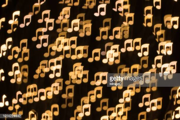 musical note shape bokeh backdrop - musical note stock photos and pictures