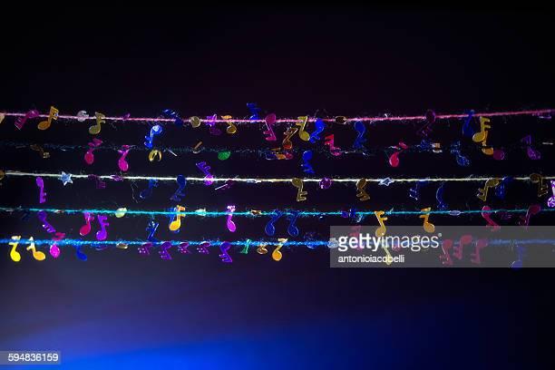 musical notes hanging on clothes lines - note de musique photos et images de collection