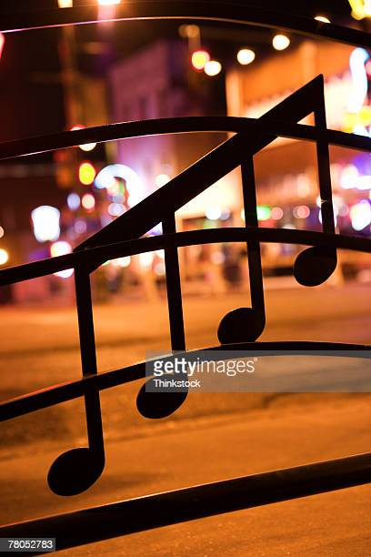 musical notes on window on beale street, memphis - memphis stock photos and pictures