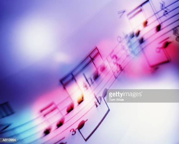 musical notes (blurred motion) - musical note stock photos and pictures