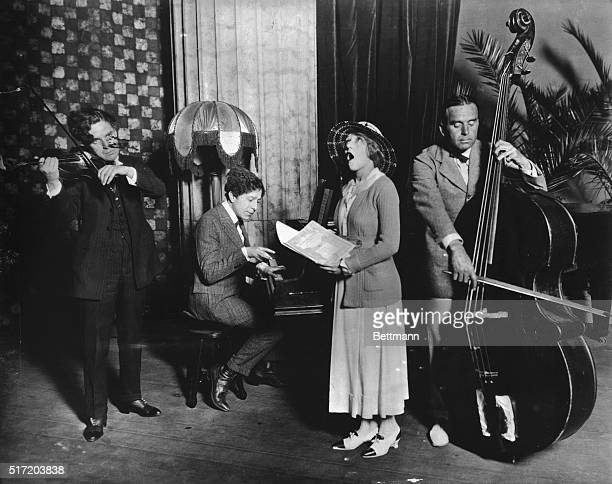 Charlie Chaplin with violin Mary Pickford singing and Douglas Fairbanks Sr with string bass
