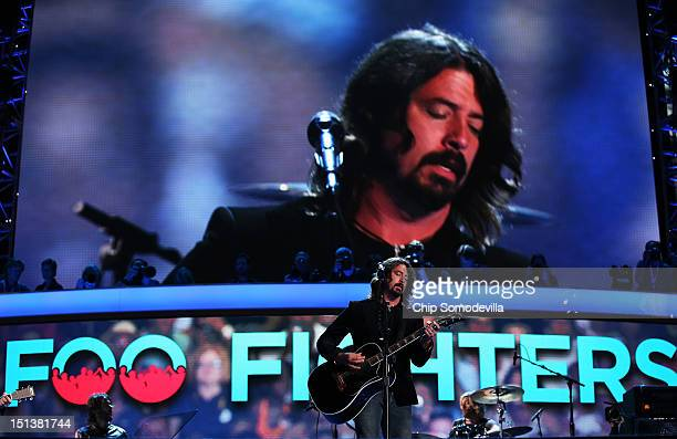 Musican Dave Grohl of the Foo Fighters performs during the final day of the Democratic National Convention at Time Warner Cable Arena on September 6...