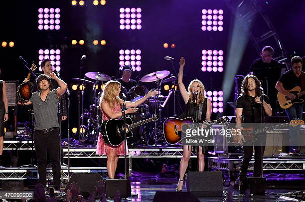 Musican Deana Carter performs with Neil Perry Kimberly Perry and Reid Perry of The Band Perry onstage during ACM Presents Superstar Duets at Globe...