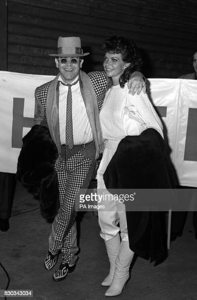 Musican Elton John and his wife Renate after arriving from an 11 month World tour on the QE2 which docked at Southampton