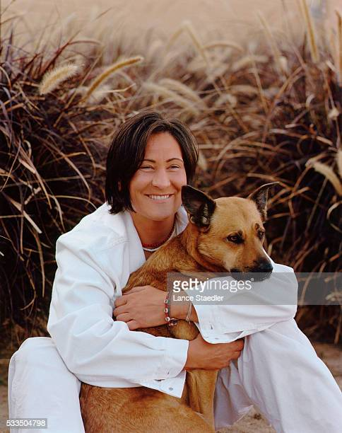 Musican kd lang is photographed for Elle Magazine US with dog Saylor in 2000 in Los Angeles California