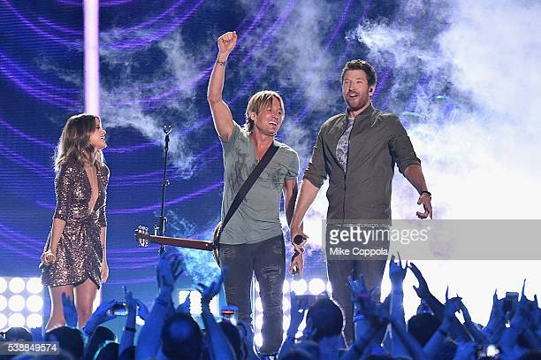 Musican Maren Morris singer Keith Urban and singersongwriter Brett Eldredge onstage during the 2016 CMT Music awards at the Bridgestone Arena on June...