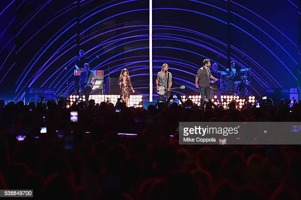 Musican Maren Morris singer Keith Urban and singersongwriter Brett Eldredge onstage during the 2016 CMT Music awards at the Bridgestone Arena on June...