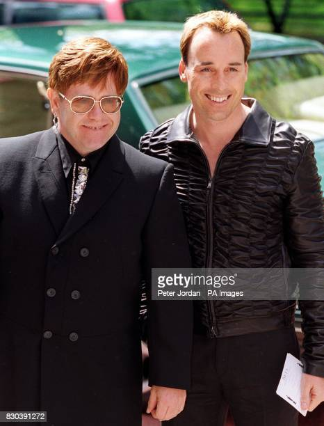 Musican Sir Elton John and partner David Furnish arrive at the Ivor Novello Award ceremony in London Sir Elton was rewarded for his contribution to...