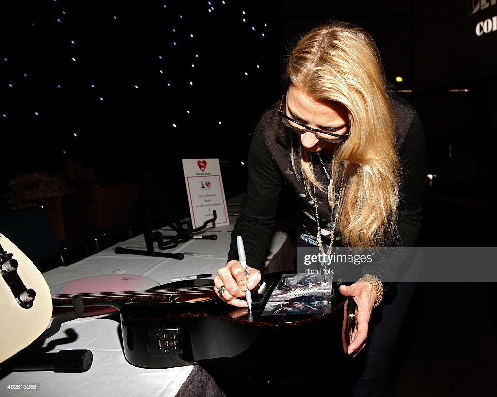 Musican Susan Tedeschi attends the Auction Signings at MusiCares Person of the Year during The 57th Annual GRAMMY Awards at the Los Angeles Convention Center on February 5, 2015 in Los Angeles, California.