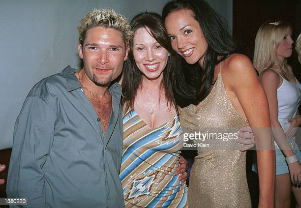 Musican/actor Corey Feldman poses with actress GinaRaye Carter and fiance Susie Sprague during Feldman's record release party at the Barfly on August...