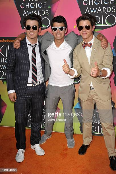 Musicans Kevin Jonas, Joe Jonas and Nick Jonas of Jonas Brothers arrive at Nickelodeon's 23rd annual Kid's Choice Awards at Pauley Pavilion on March...
