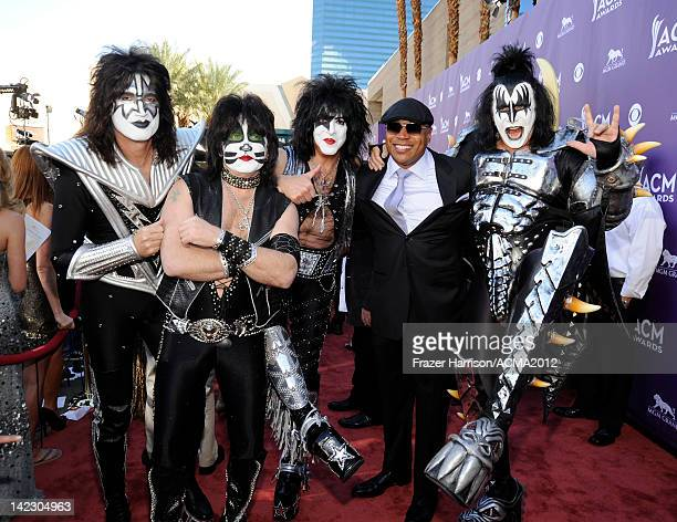 Musicans Tommy Thayer Eric Singer and Paul Stanley of Kiss LL Cool J and Gene Simmons of Kiss arrive at the 47th Annual Academy Of Country Music...