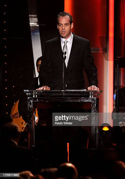 MusiCares Foundation Board Chair and President Time Inc Entertainment Group Paul Caine speaks onstage at 2011 MusiCares Person of the Year Tribute to...