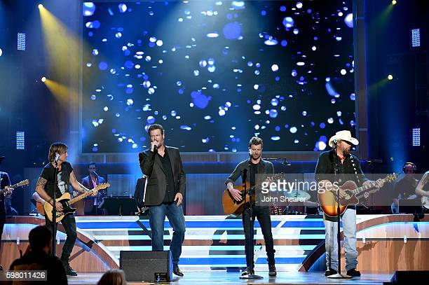 Musicial artisits Keith Urban Blake Shelton Bierks Bentley and Toby Keith perform onstage during the 10th Annual ACM Honors at the Ryman Auditorium...