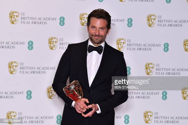 US musician actor and director Bradley Cooper poses with the award for Original Music for their work on the film 'A Star Is Born' at the BAFTA...