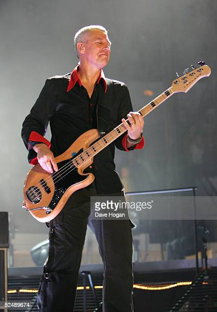 Musician Adam Clayton of U2 performs on stage on the first night of their Vertigo//2005 World Tour at the San Diego Sports Arena on March 28 2005 in...