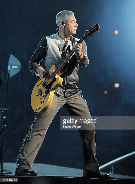 Musician Adam Clayton of U2 performs onstage during their '360 Degrees Tour' at the Rose Bowl on October 25 2009 in Pasadena California