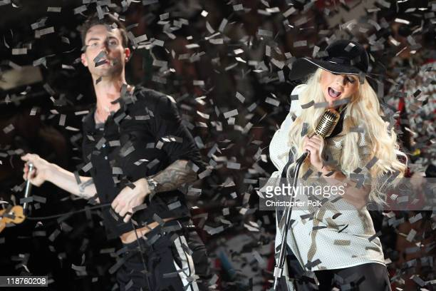 Musician Adam Levine of the band Maroon 5 and singer Christina Aguilera perform at the Maroon 5 Video Shoot for 'Moves Like Jagger' with Christina...