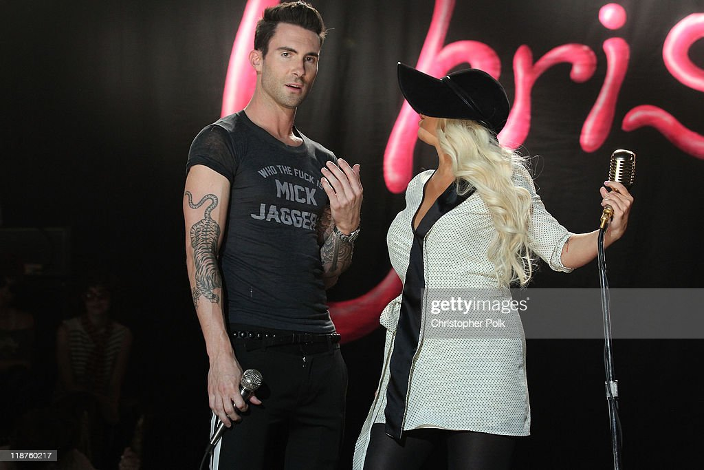 Musician Adam Levine of the band Maroon 5 and singer Christina Aguilera perform at the Maroon 5 Video Shoot for 'Moves Like Jagger' with Christina Aguilera on July 8, 2011 in Los Angeles, California.