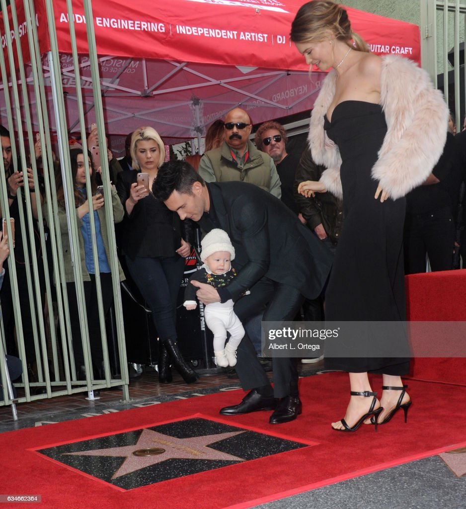 Musician Adam Levine, wife/model Behati Prinsloo and daughter Dusty Rose at his Star On The Hollywood Walk Of Fame ceremoney on February 10, 2017 in Hollywood, California.