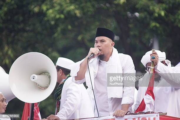 Musician Ahmad Dhani oration against government on on Jihad constitution vehicle joined Islamic Defender Front and politician leaders in front of...