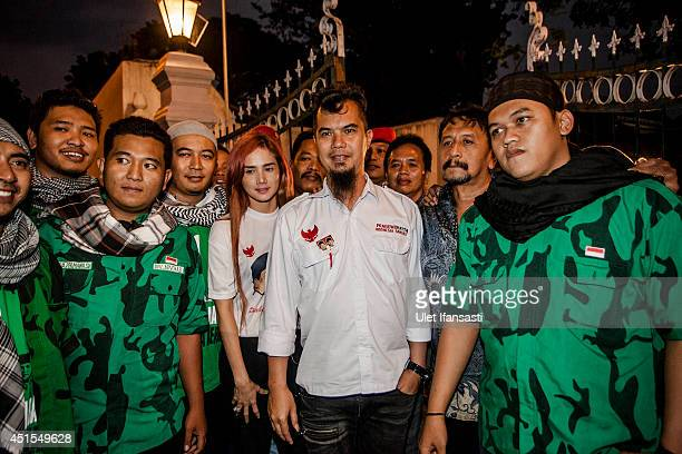 A musician Ahmad Dhani poses with supporters during Presidential candidate Prabowo Subianto meets with Sultan of Yogyakarta Hamengkubuwono X on at...