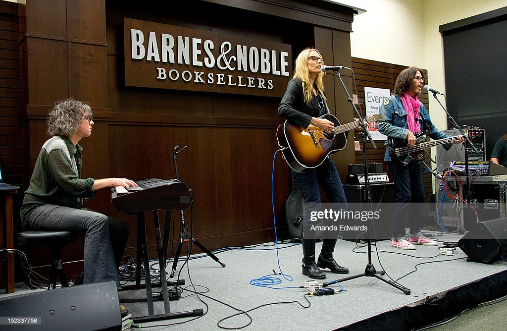 Musician Aimee Mann performs onstage before signing copies