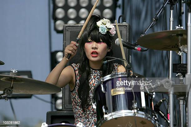 Musician Akiko Matsuura performs in concert with The Big Pink during the 2010 Lollapalooza festival in Grant Park on August 6 2010 in Chicago Illinois