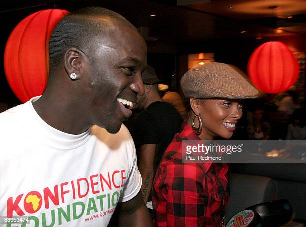 Musician Akon and Actress/model Eva Pigford attend Children's Holiday Bowl and Toy Drive benefiting the Children of South LA's youth center A Place...