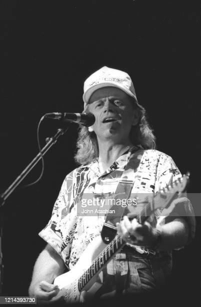 Musician Al Jardine is shown performing on stage during a live concert appearance with The Beach Boys on June 1 1991