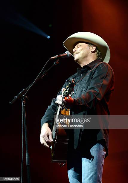 Musician Alan Jackson performs onstage during the 51st annual ASCAP Country Music Awards at Music City Center on November 4 2013 in Nashville...