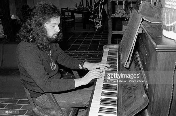 Musician Alan Stivell plays the piano at his home in France Stivell known for his harp playing is credited with reviving Celtic music in the late...
