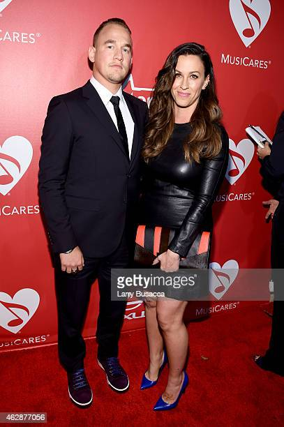 Musician Alanis Morissette and Mario Treadway attend the 25th anniversary MusiCares 2015 Person Of The Year Gala honoring Bob Dylan at the Los...