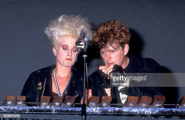 Musician Alannah Currie and musician Tom Bailey of pop group Thompson Twins perform in concert on July 23 1987 at Pier 84 in New York City