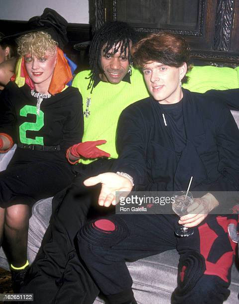 Musician Alannah Currie musician Joe Leeway and musician Tom Bailey of Thompson Twins on April 1 1984 party at The Limelight in New York City