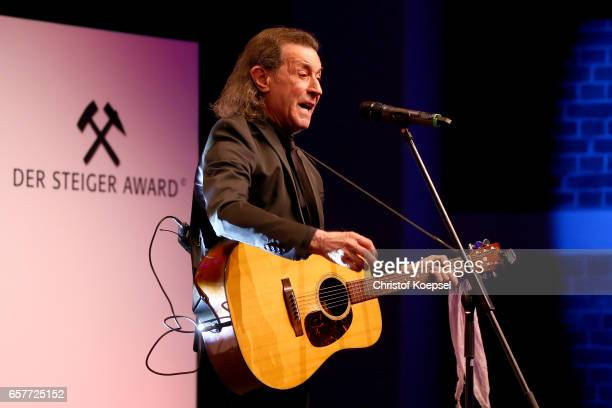 Musician Albert hammond sings after winnin g the music award during the Steiger Award on at Coal Mine Hansemann Alte Kaue March 25 2017 in Dortmund...