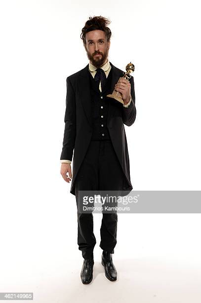 Musician Alex Ebert winner of Best Original Score for 'All is Lost' poses for a portrait during the 71st Annual Golden Globe Awards held at The...