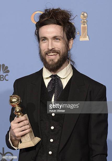 Musician Alex Ebert winner of Best Original Score for 'All is Lost' poses in the press room during the 71st Annual Golden Globe Awards held at The...