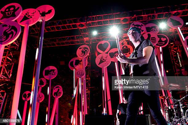 Musician Alex Gaskarth of All Time Low performs onstage during the MTV Fandom Fest San Diego ComicCon at PETCO Park on July 9 2015 in San Diego...