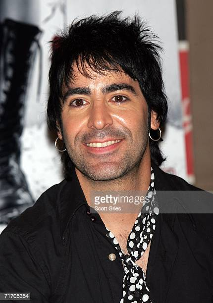 Musician Alex Gonzalez of Mana signs copies of their new CD 'Amar Es Combatir' at Virgin Megastore Times Square on August 23 2006 In New York City