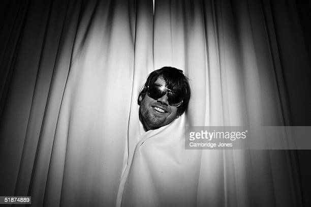 Musician Alex James poses at a photoshoot in London on the 14th of July 2004