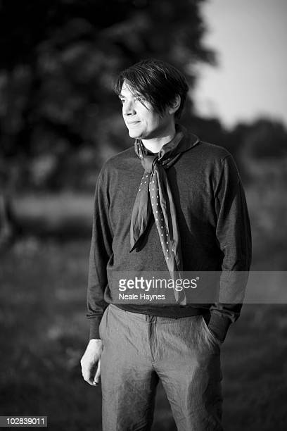 Musician Alex James poses for a portrait shoot at his Cotswold farm UK for Live Night Day magazine