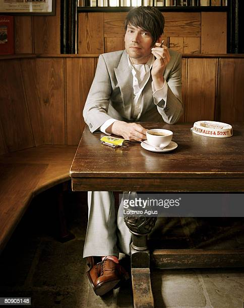 Musician Alex James poses for a portrait shoot for Harpers Bazaar magazine London on May 16 2007