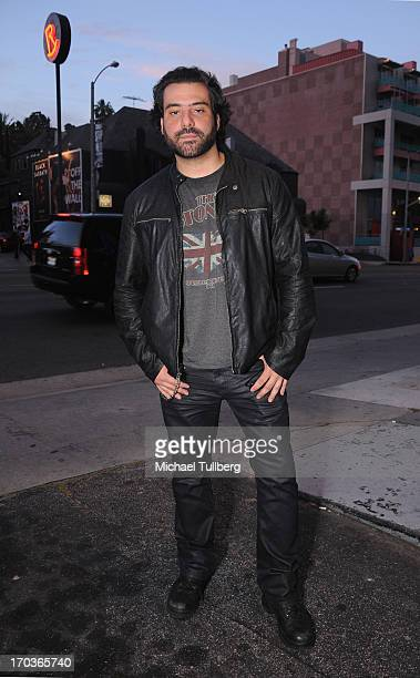 Musician Alex Sassaris of the rock group Eve To Adam poses in front of The Roxy Theatre on June 11 2013 in West Hollywood California