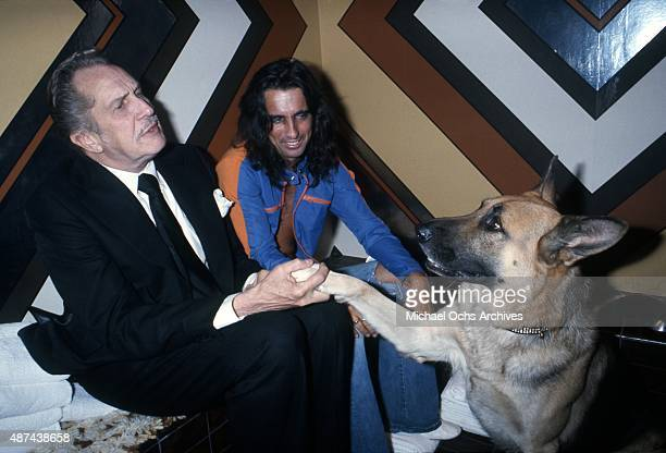 Musician Alice Cooper and actor Vincent Price attend a party for the film 'Won Ton Ton The Dog Who Saved Hollywood' in December 1975 in Los Angeles...