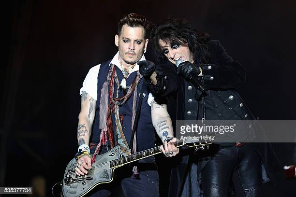 Musician Alice Cooper and Actor/Musician Johnny Depp of Hollywood Vampires perform onstage at HessentagsArena during the 56th Hessentag on May 29...
