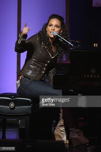 Musician Alicia Keys performs during 'Giving Live At The Apollo' presented by the MTV and Clinton Global Initiative at the Apollo Theater on...