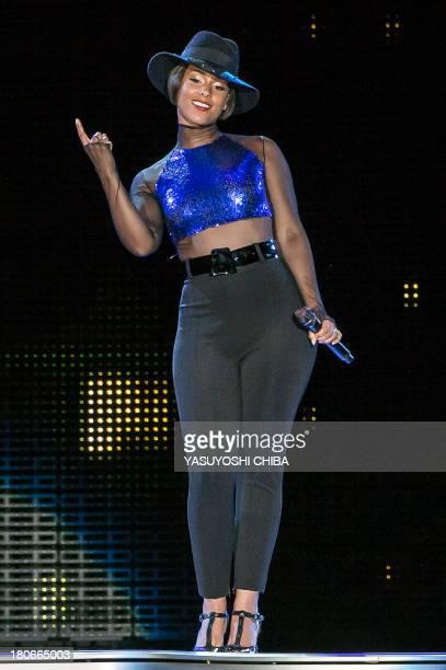 US musician Alicia Keys performs during the Rock in Rio music festival in Rio de Janeiro Brazil on September 15 2013 AFP PHOTO / YASUYOSHI CHIBA
