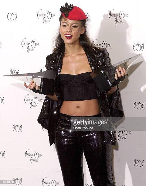 Musician Alicia Keys poses backstage during the 29th Annual American Music Awards at the Shrine Auditorium January 9 2002 in Los Angeles CA