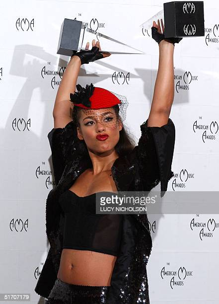 US musician Alicia Keys poses backstage with her awards for Favorite New ArtistSoul/RB and Favorite Female Artist Pop/Rock at the 29th Annual...
